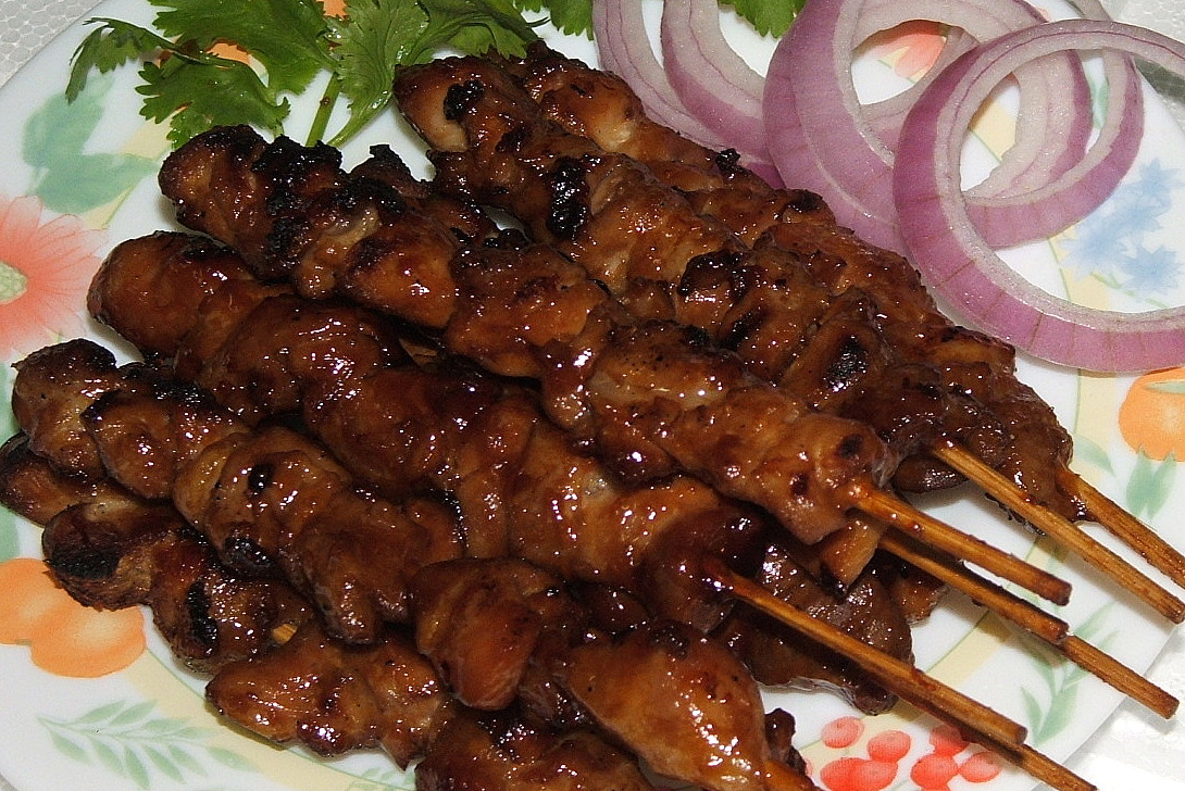 Yakitori is a Japanese delicacy consisting in skewered grilled chicken ...
